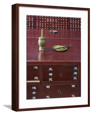 China, Beijing, Traditional Chinese Medicine Pharmacy, Scale and Mortar on the Counter-Keren Su-Framed Art Print