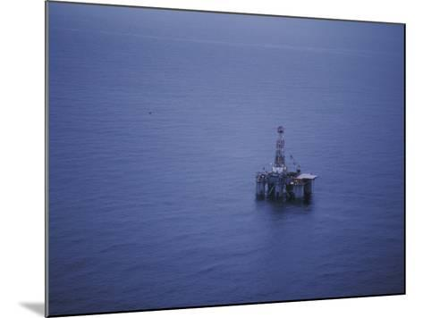 Offshore Oil Rig Surrounded by the Ocean-Jeff Foott-Mounted Photographic Print
