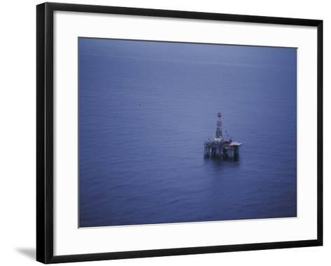 Offshore Oil Rig Surrounded by the Ocean-Jeff Foott-Framed Art Print