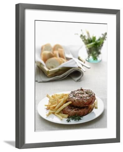 Close-Up of a Hamburger with Herbs and French Fries--Framed Art Print
