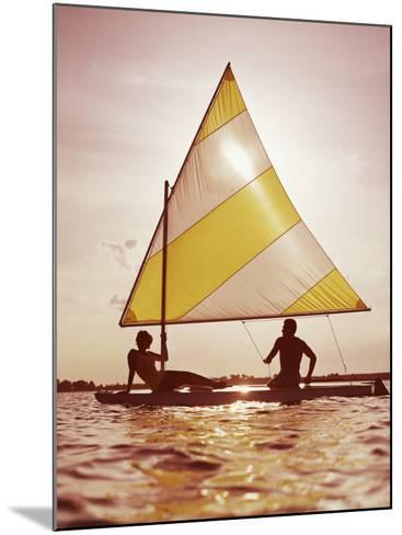 Couple Sailing on Small Boat-Dennis Hallinan-Mounted Photographic Print