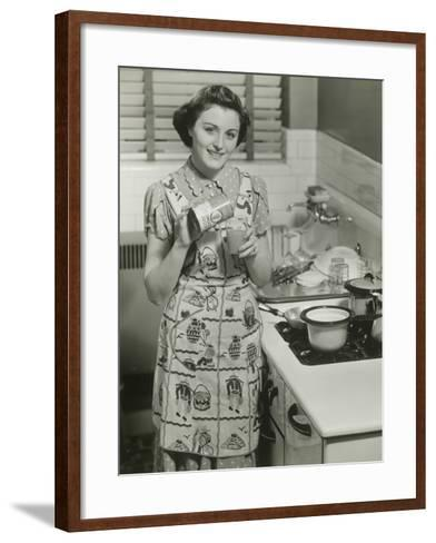 Portrait of Young Woman in Kitchen Holding Can of Soup-George Marks-Framed Art Print