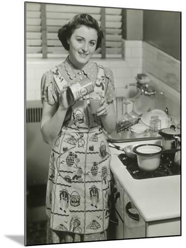 Portrait of Young Woman in Kitchen Holding Can of Soup-George Marks-Mounted Photographic Print