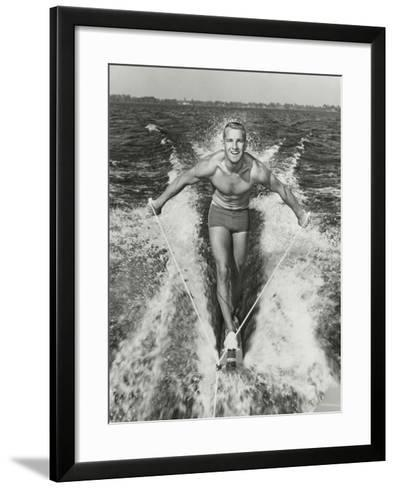 Happy Young Man Waterskiing-Dennis Hallinan-Framed Art Print