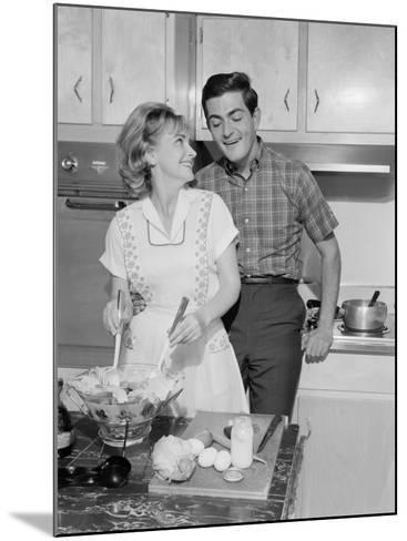 Mid Adult Couple in Kitchen, Woman Preparing Salad-George Marks-Mounted Photographic Print