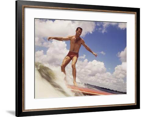 Man Riding Surf Board-Dennis Hallinan-Framed Art Print