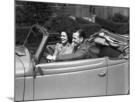 Couple Riding in Old Fashion Convertible Car-George Marks-Mounted Photographic Print