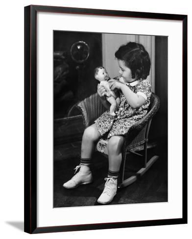 Girl (3-4) Sitting on Rocking-Chair, Playing with Doll-George Marks-Framed Art Print