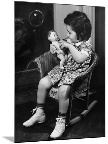 Girl (3-4) Sitting on Rocking-Chair, Playing with Doll-George Marks-Mounted Photographic Print