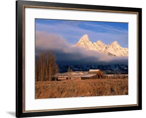 View of Historic Old Barn and Snow-Covered Teton Mountain Range-Jeff Foott-Framed Art Print