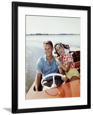 Smiling Retro Couple Enjoying a Speed Boat Ride-Dennis Hallinan-Framed Art Print