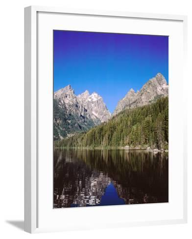 View of Grand Teton and Mount Owen Reflected in Calm Waters of Jenny Lake-Jeff Foott-Framed Art Print