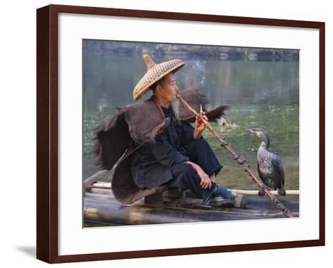 China, Guangxi Province, Yangshuo, Fisherman Smoking a Pipe on the Bamboo Raft on the Li River-Keren Su-Framed Art Print