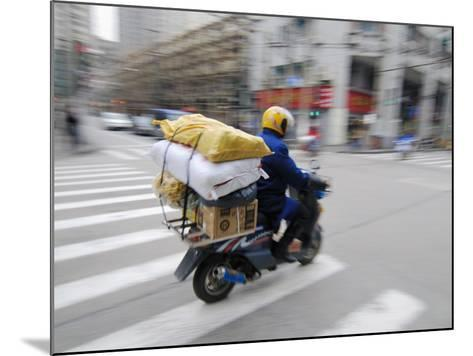 Man with Packages on Scooter--Mounted Photographic Print