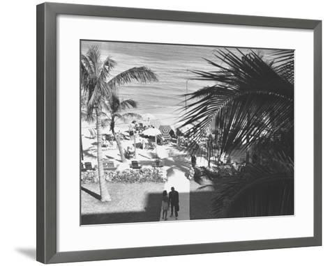 Couple Walking in Path Towards Beach, (B&W), Elevated View-George Marks-Framed Art Print