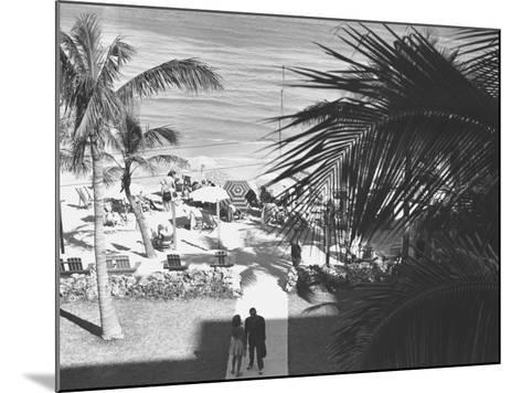 Couple Walking in Path Towards Beach, (B&W), Elevated View-George Marks-Mounted Photographic Print