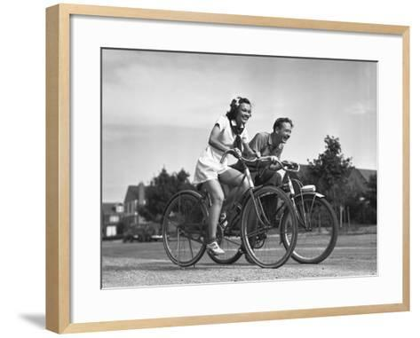 Man and Woman Riding Bicycles, (B&W),-George Marks-Framed Art Print
