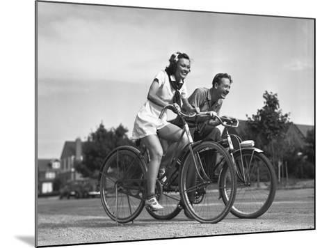 Man and Woman Riding Bicycles, (B&W),-George Marks-Mounted Photographic Print