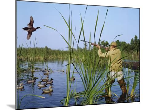 Hunter Aiming Rifle at Flying Duck-Dennis Hallinan-Mounted Photographic Print