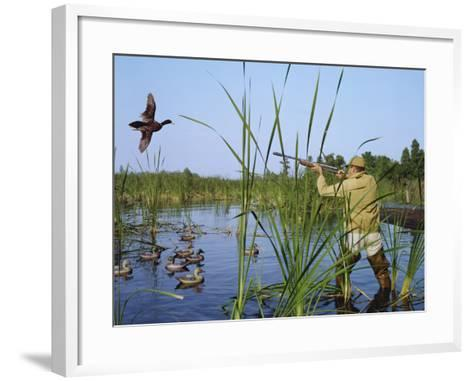 Hunter Aiming Rifle at Flying Duck-Dennis Hallinan-Framed Art Print