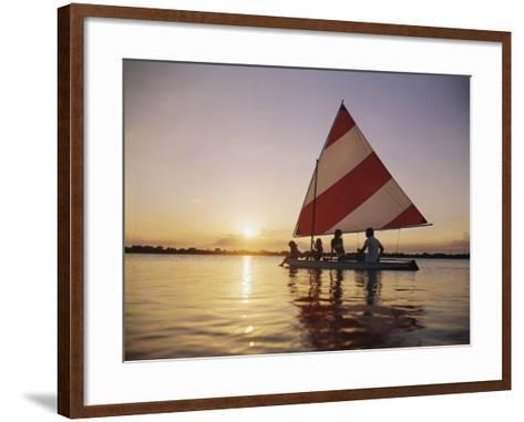 Family Sailing in Lake at Sunset-Dennis Hallinan-Framed Art Print