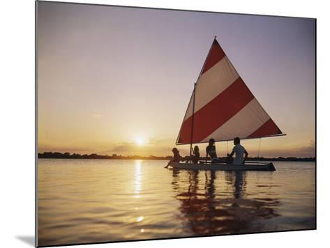 Family Sailing in Lake at Sunset-Dennis Hallinan-Mounted Photographic Print