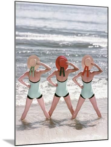 Women Standing on Beach in Ocean-Dennis Hallinan-Mounted Photographic Print