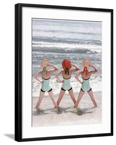 Women Standing on Beach in Ocean-Dennis Hallinan-Framed Art Print