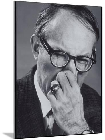 Older Man Pinching His Nose Closed-Lambert-Mounted Photographic Print