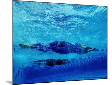 Two Female Swimmers Performing Racing Turns, Underwater View--Mounted Photographic Print