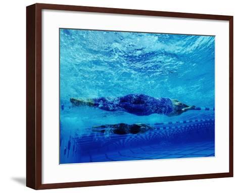 Two Female Swimmers Performing Racing Turns, Underwater View--Framed Art Print
