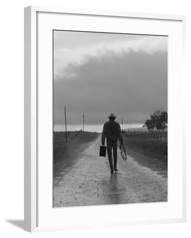Silhouette of Cowboy Walking on Empty Road--Framed Art Print