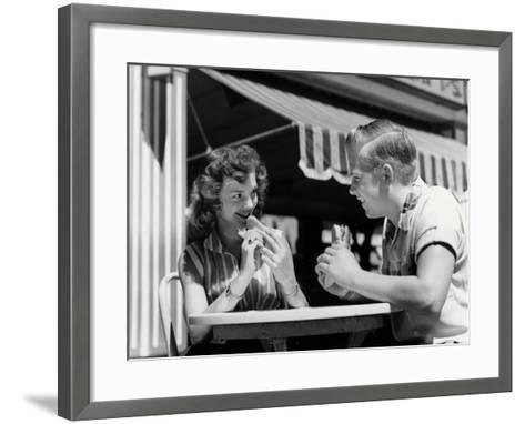 Couple Eating Hot Dogs-H^ Armstrong Roberts-Framed Art Print