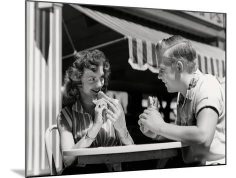 Couple Eating Hot Dogs-H^ Armstrong Roberts-Mounted Photographic Print