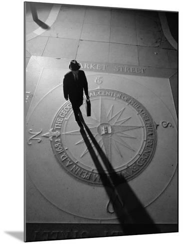 Silhouetted Businessman With Briefcase Walking Across Compass in the Sidewalk-H^ Armstrong Roberts-Mounted Photographic Print