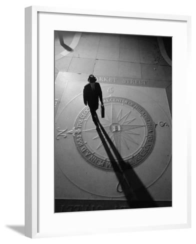 Silhouetted Businessman With Briefcase Walking Across Compass in the Sidewalk-H^ Armstrong Roberts-Framed Art Print