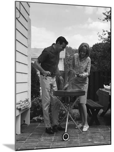 Man Barbecuing Steak-H^ Armstrong Roberts-Mounted Photographic Print