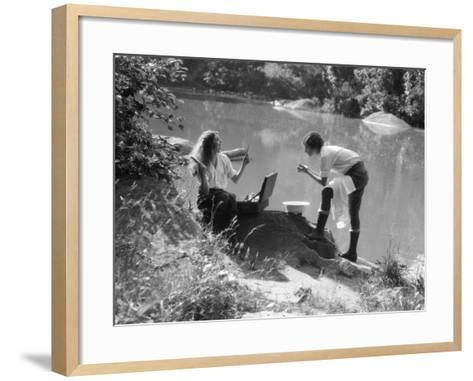 Two Women Camping at Lakeside, One Combs Her Hair-H^ Armstrong Roberts-Framed Art Print