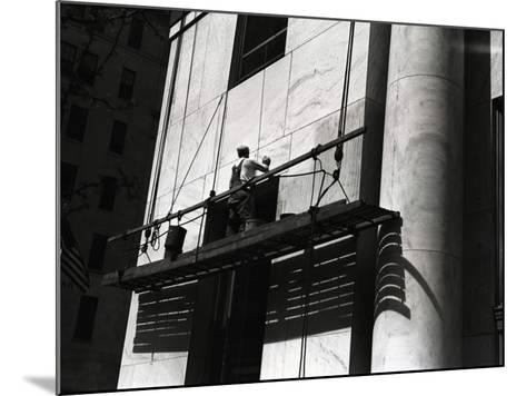 Man Working on Platform Hanging From Building-George Marks-Mounted Photographic Print