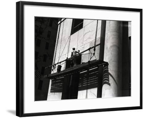 Man Working on Platform Hanging From Building-George Marks-Framed Art Print