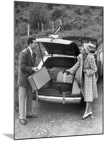 Couple Unloading Luggage From Trunk of Car-George Marks-Mounted Photographic Print