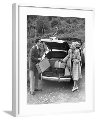 Couple Unloading Luggage From Trunk of Car-George Marks-Framed Art Print