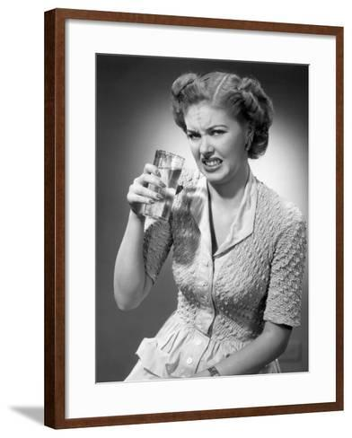 Woman Drinking Glass of Water With Look of Disgust-George Marks-Framed Art Print