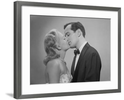 Studio Shot of Kissing Couple in Evening Wear-George Marks-Framed Art Print
