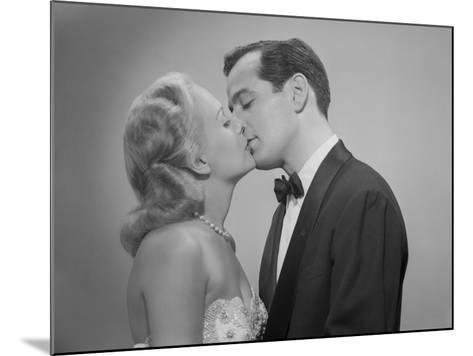 Studio Shot of Kissing Couple in Evening Wear-George Marks-Mounted Photographic Print