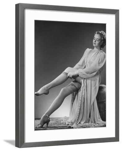 Young Woman Putting on Stockings in Studio-George Marks-Framed Art Print