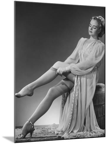 Young Woman Putting on Stockings in Studio-George Marks-Mounted Photographic Print