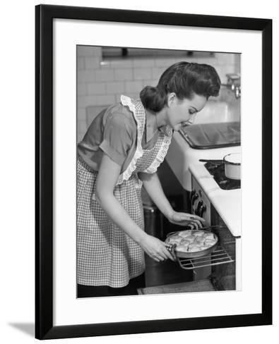 Woman Taking Biscuits Out of the Oven-George Marks-Framed Art Print