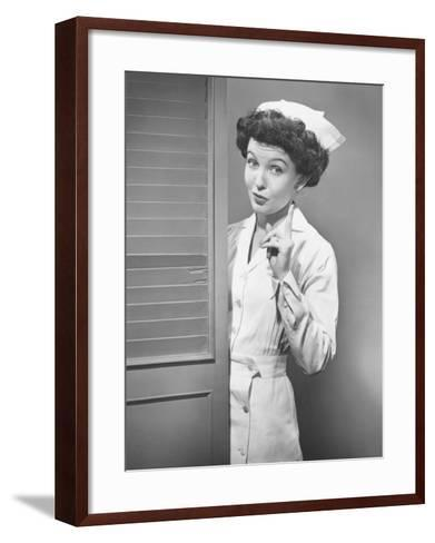 Nurse Pointing at Opened Doors (B&W)-George Marks-Framed Art Print