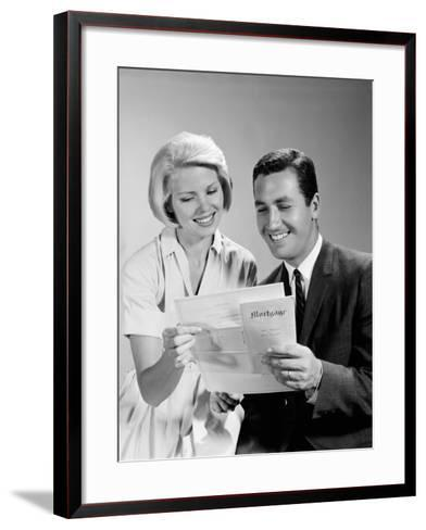 Husband and Wife Homeowners Looking at Mortgage and Smiling-H^ Armstrong Roberts-Framed Art Print